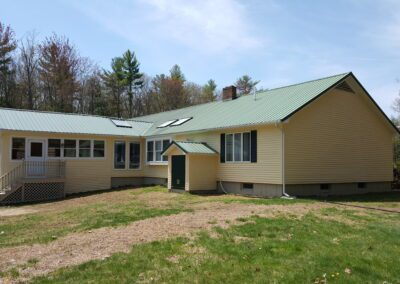 This is an exterior painting project in Goodwin Mills Limington Me