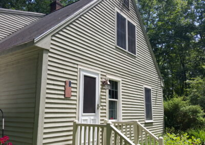 This is an exterior painting project in County Rd Limington Me