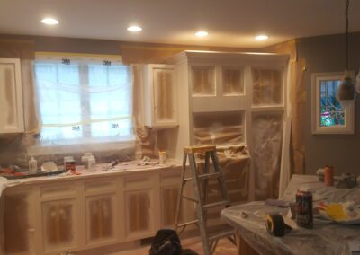 This is a cabinet painting project in Biddeford ME