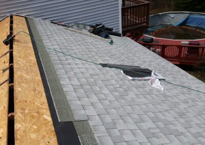 This is a roofing project in 302 Windham Me